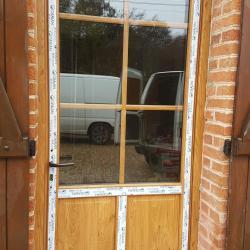 Porte pvc plaxe winchester exterieur blanc interieur veine